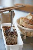 Farmhouse pat,Baguette and a jar of gherkins
