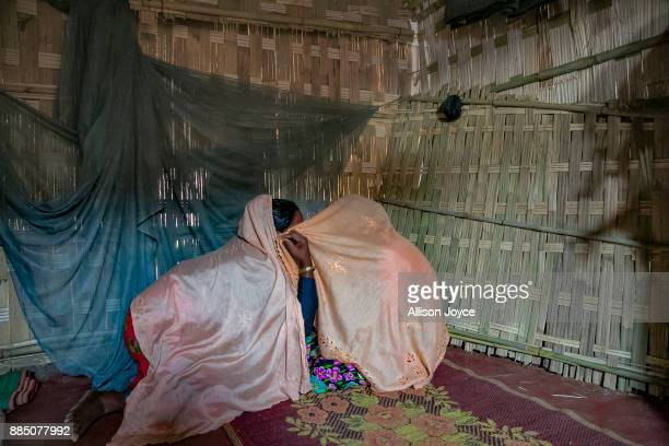 COX'S BAZAR BANGLADESH NOVEMBER 27 Farmina Begum talks to her friend on the day of her wedding to 18 year old Hashimullah in a Bangladesh refugee...