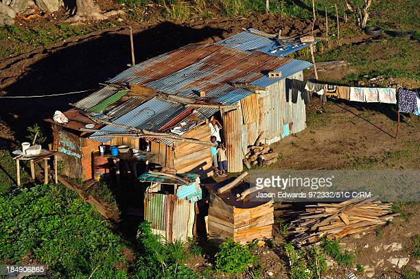 A farming family waves from their corrugated tin home to a balloon Viti Levu Pacific Ocean Fiji Islands