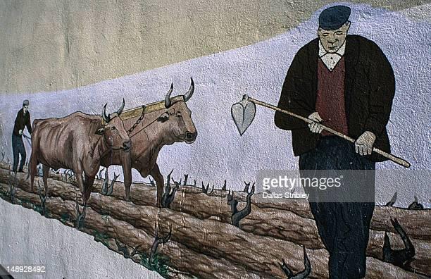 Farming mural on house wall in Mamoiada in the Barbagia region.