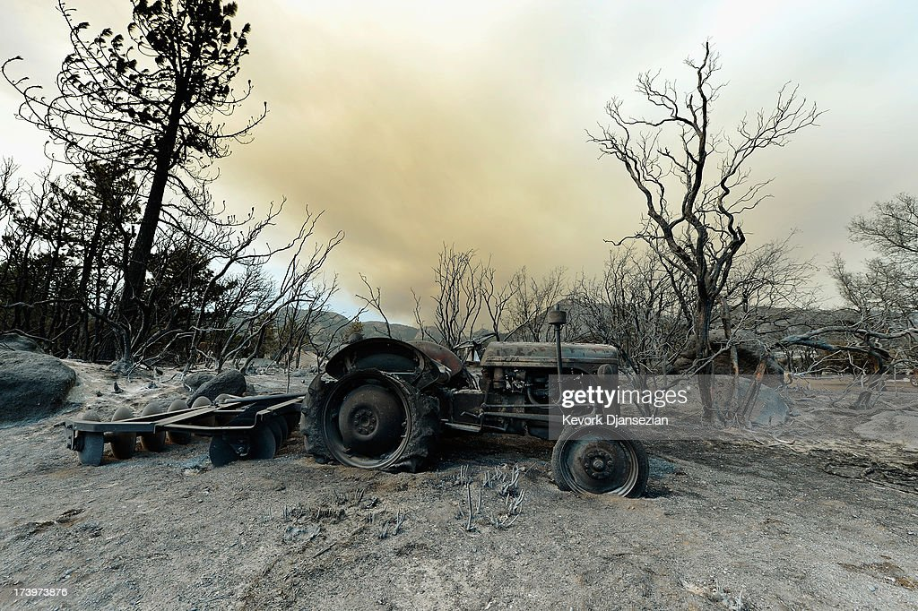 A farming tractor is left in the wake of the Mountian Fire after it scorched the area on July 18, 2013 near Idyllwild, California. The massive wildfire in Riverside county has grown to 23,000 acres and is advancing towards the mountain town of Idyllwild on one front and city of Palm Springs on the other front destroying several homs and forcing the evacuation of 6,000 people.