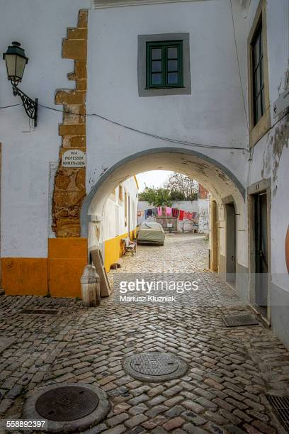 Faro old town cobbled street and arch passage