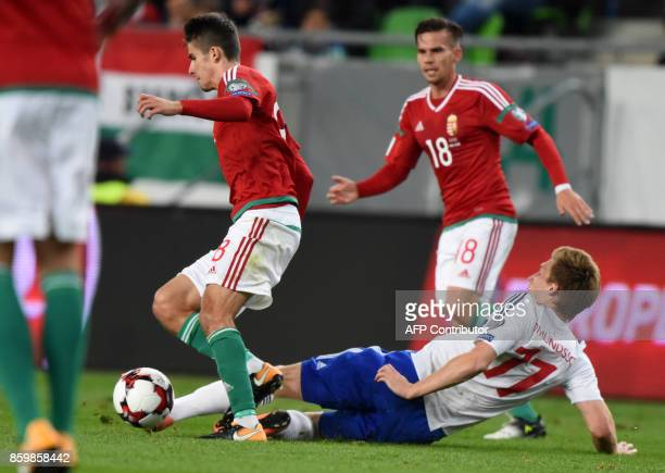 Faroe Islands' Joan Edmundsson vies with Hungary's Adam Nagy and Zoltan Stieber during the FIFA World Cup 2018 qualification football match between...