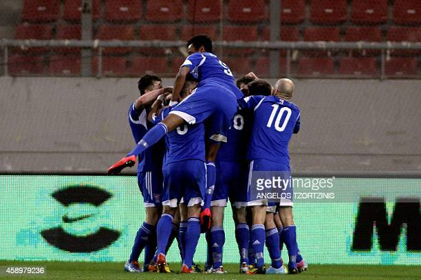 Faroe Island's players celebrate after scoring a goal during the UEFA Euro 2016 group F qualifying football match between Greece and Faroe Island at...
