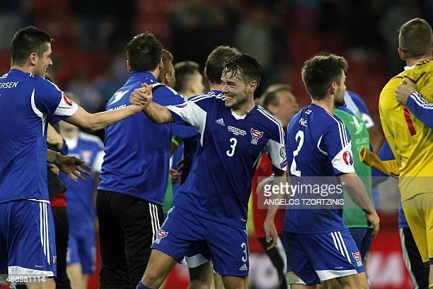 Faroe Island's players celebrate after winning the UEFA Euro 2016 group F qualifying football match between Greece and Faroe Island at the Karaiskaki...