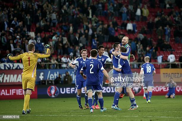 Faroe Island's players celebrate after winning the UEFA Euro 2016 group F qualifying football match between Greece and Faroe Island at the Karaiskaki...
