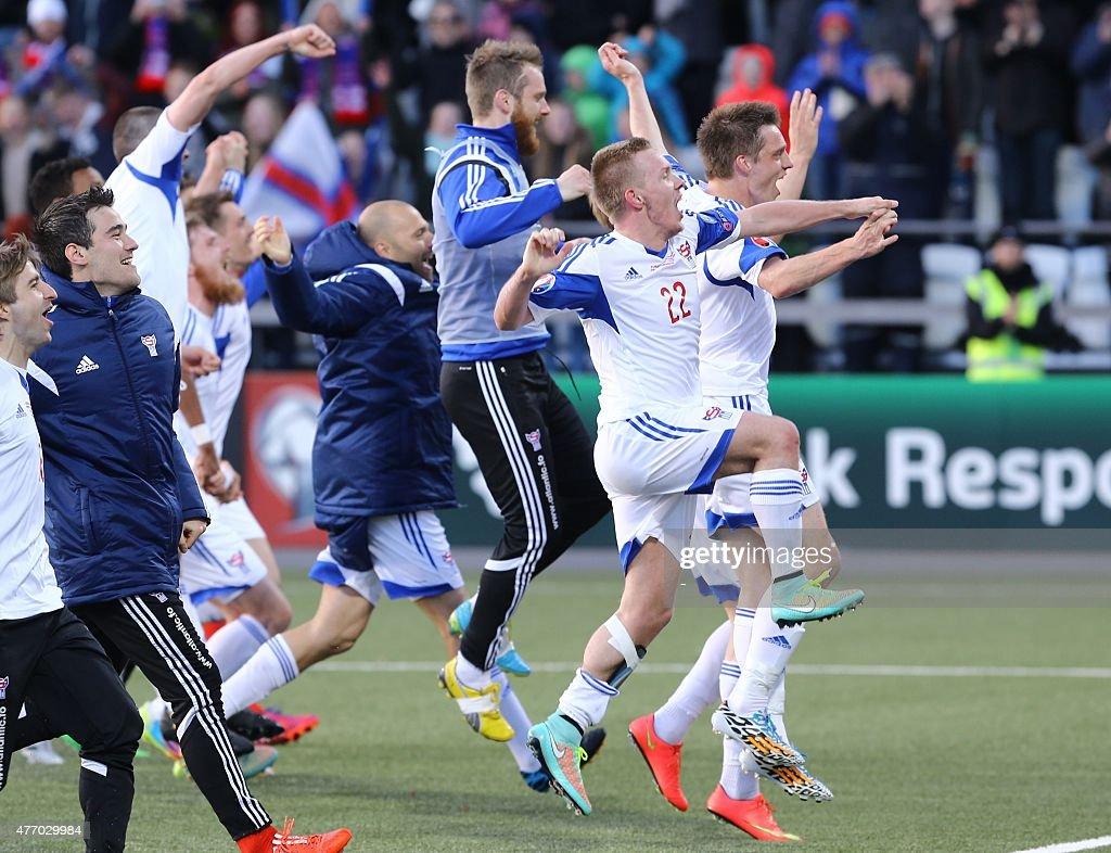 Faroe Island's players celebrate after winning the UEFA Euro 2016 group F qualifying football match between Faroe Island and Greece in Torshavn on...