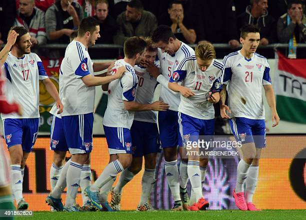Faroe Island's players celebrate scoring during the Euro 2016 Group F qualifying football match between Hungary and Faroe Islands at the Groupama...