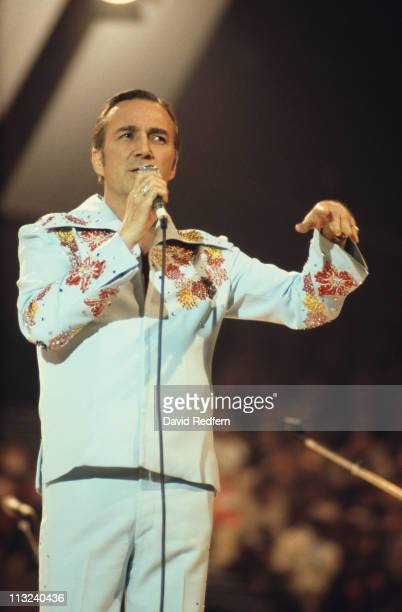 Faron Young US country music singersongwriter singing into a microphone during a live concert performance at the International Festival of Country...