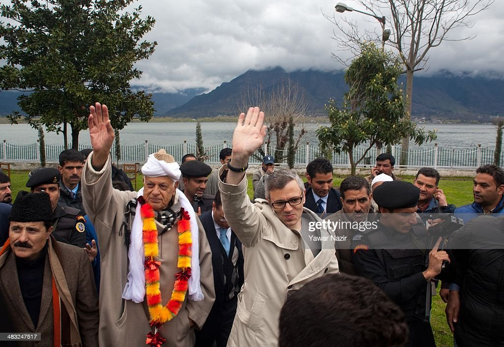 <a gi-track='captionPersonalityLinkClicked' href=/galleries/search?phrase=Farooq+Abdullah&family=editorial&specificpeople=2291127 ng-click='$event.stopPropagation()'>Farooq Abdullah</a>, a minister in the Indian government and patron of the pro-India National Conference (NC) party and a contesting candidate, along with his son, <a gi-track='captionPersonalityLinkClicked' href=/galleries/search?phrase=Omar+Abdullah&family=editorial&specificpeople=619022 ng-click='$event.stopPropagation()'>Omar Abdullah</a>, Jammu and Kashmir chief minister, waves to their supporters after filing his nomination papers for Srinagar seat for the lower house of parliament on April 07, 2014, in Srinagar, the summer capital of Indian administered Kashmir, India. Indian Kashmir, with six Lok Sabha (general elections) seats, will vote for five days on April 10, 17, 24, 30 and May 7 for the Lok Sabha elections amid tight security arrangements and a boycott appeal by pro-independence groups .