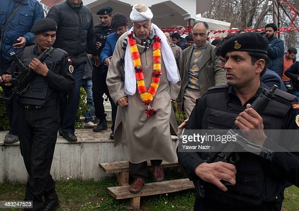 Farooq Abdullah a minister in the Indian government and patron of the proIndia National Conference party and a contesting candidate is escorted by...