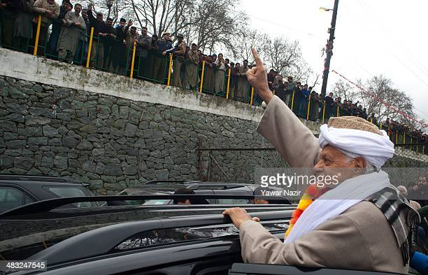 Farooq Abdullah a minister in the Indian government and patron of the proIndia National Conference party and a contesting candidate waves to his...