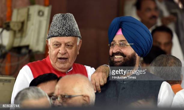 Farooq Abdullah along with Pratap Singh Bajwa after swearing in ceremony of the new president Ram Nath Kovind at Parliament House on July 25 2017 in...