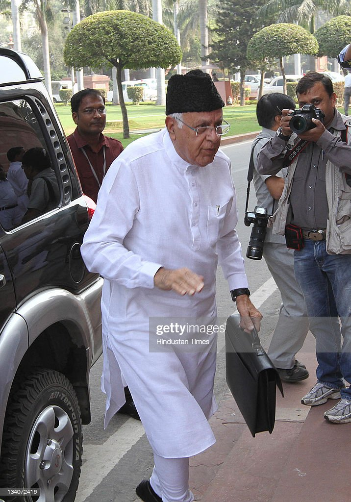 <a gi-track='captionPersonalityLinkClicked' href=/galleries/search?phrase=Farooq+Abdullah&family=editorial&specificpeople=2291127 ng-click='$event.stopPropagation()'>Farooq Abdullah</a> arrives at Parliament house during the third day of winter session at Parliament House on November 24, 2011 in New Delhi, India. Parliament was to look over 32 different longstanding bills.