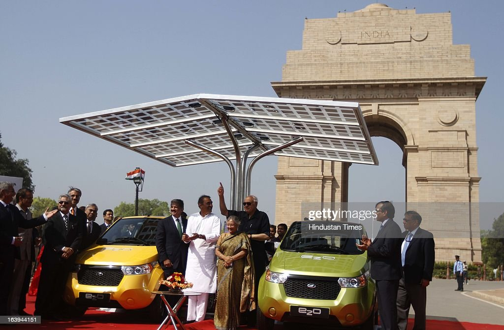Farooq Abdullah, Renewable Energy Minister, Praful Patel, Industries Minister, Delhi Chief Minister Sheila Dikshit with Anand Mahindra, Chairman & Managing Director Mahindra & Mahindra launch of Mahindra 'e2o' standing under a solar canopy at India Gate on March 18, 2013 in New Delhi, India. The four-seater, two-door e2o is priced at 596,000 rupees ($11,000) has zero emissions an 80 kmh (50 mph) top speed, is automatic and can run for 100 kilometres on a single charge.