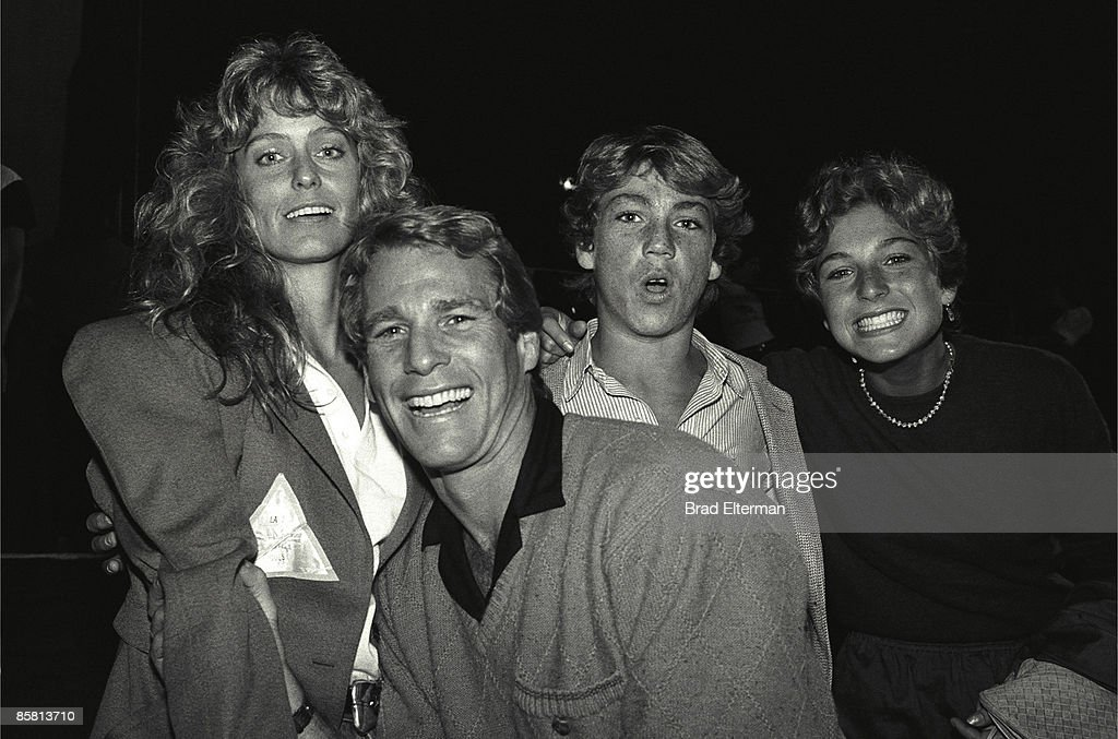 Farrah Fawcett, Ryan O'Neil, Griffin O'Neal and Tatum O'Neal backstage at a Rolling Stones concert circa 1980 in Los Angeles, California.**EXCLUSIVE**