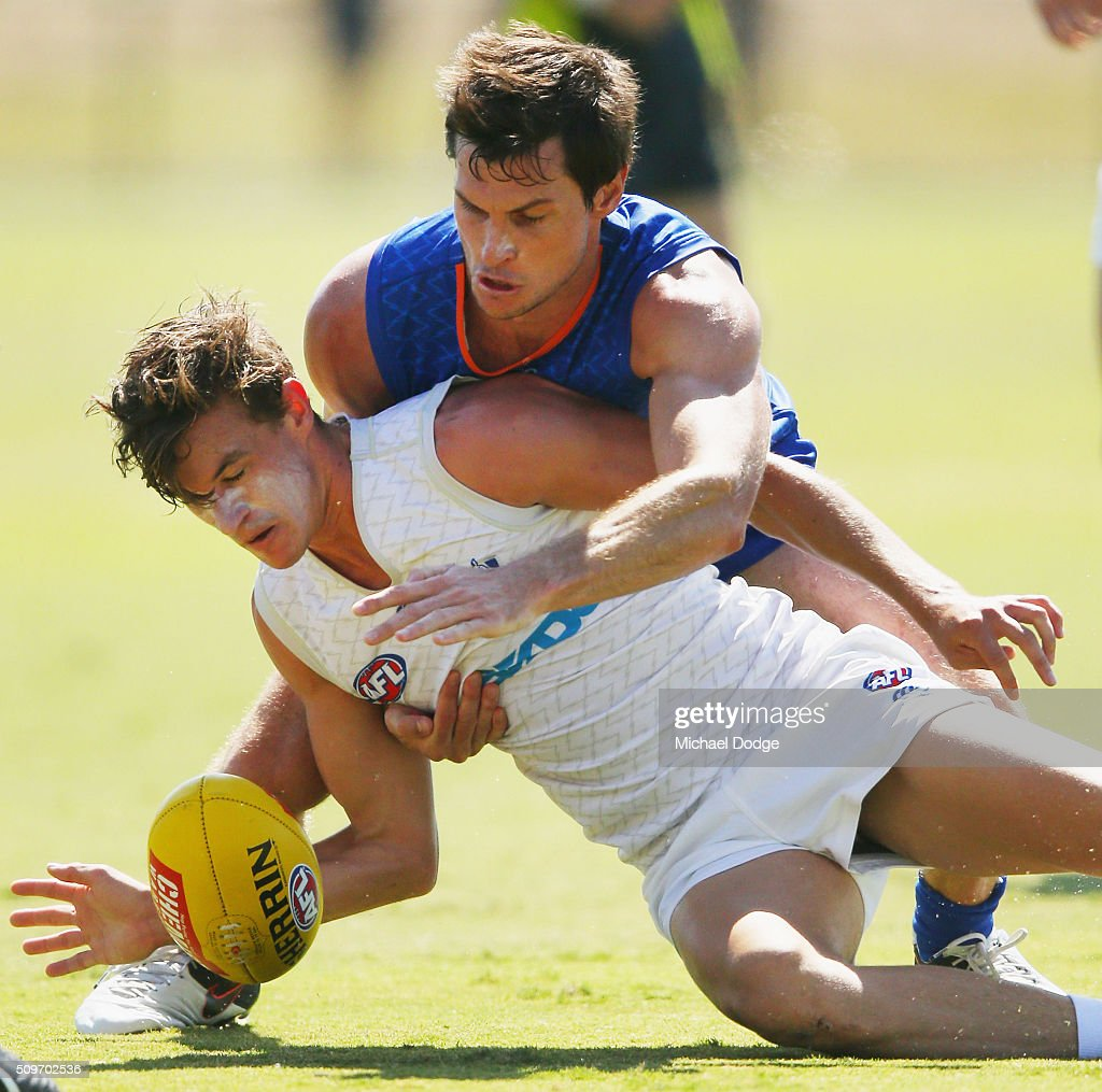 <a gi-track='captionPersonalityLinkClicked' href=/galleries/search?phrase=Farren+Ray&family=editorial&specificpeople=563287 ng-click='$event.stopPropagation()'>Farren Ray</a> lays a tackle during the North Melbourne AFL Intra-Club match at Arden Street Ground on February 12, 2016 in Melbourne, Australia.