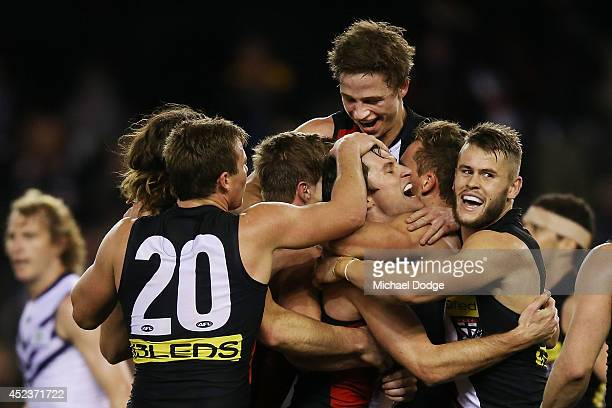 Farren Ray of the Saints gets mobbed after kicking a goal during the round 18 AFL match between the St Kilda Saints and the Fremantle Dockers at...