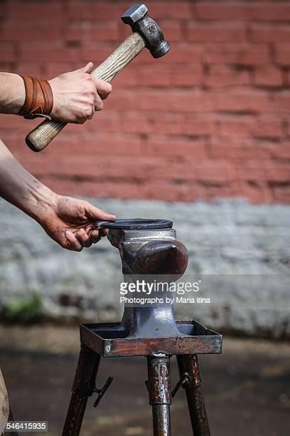 Farrier making horseshoe