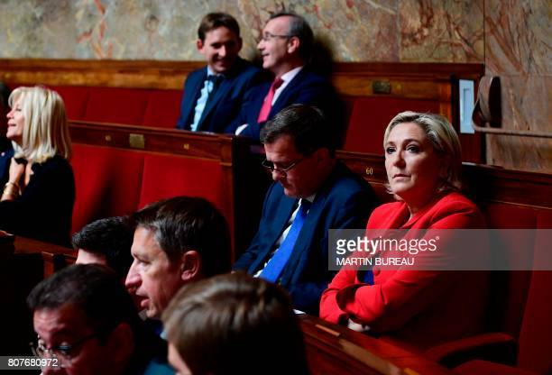 Farrigh Front National party's Members of Parliament Marine Le Pen and her companion Louis Aliot attend the address of the French Prime Minister's...