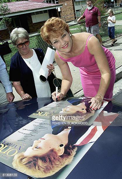 Farright antiimmigration advocate and former MP Pauline Hanson autographs One Nation party posters in the hinterland town of Gatton 17 February 2001...