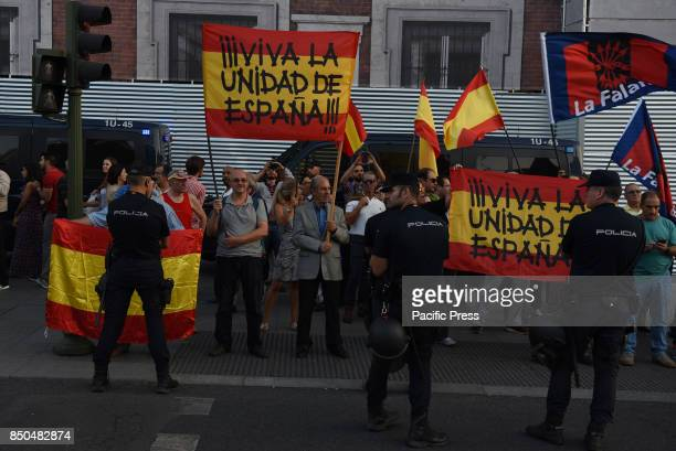 Farright demonstrators hold Spanish flags and shout slogans at protesters supporting the Catalan bid to hold a referendum on independence during a...