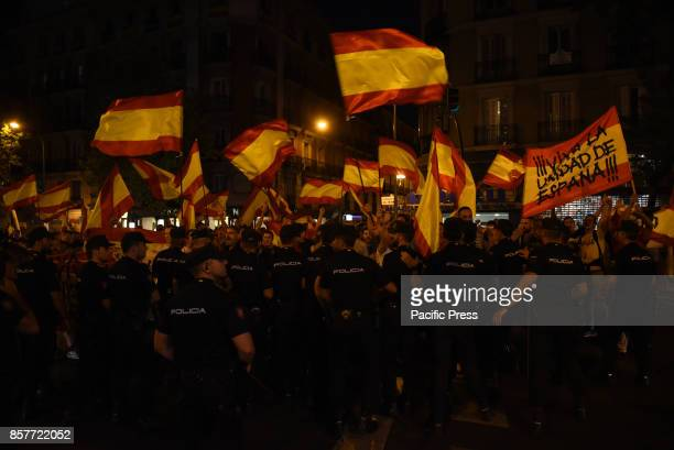 Farright demonstrators wave Spanish flags and shout slogans in favour of united Spain as they take part in a protest in front of Partido Popular...