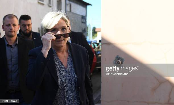 Farright Front National party leader Marine Le Pen arrives at the FN Federation of Vaucluse during a press conference on October 08 2017 in...
