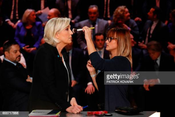 Farright Front National party Marine Le Pen receives make up before a debate organised by the French private TV channel TF1 between five candidates...