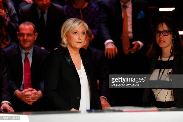 Farright Front National party Marine Le Pen waits before taking part in a debate organised by the French private TV channel TF1 between five...