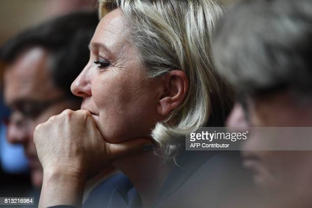 Farright Front National party member of parliament Marine Le Pen attends a session of questions to the government at the French National Assembly in...