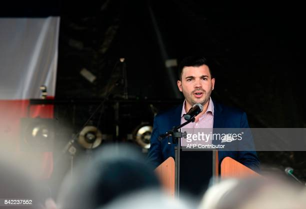 Farright National Front party mayor of Hayange Fabien Engelmann delivers a speech during the party's 'Pig Fest' or 'La fete du cochon' on September 3...