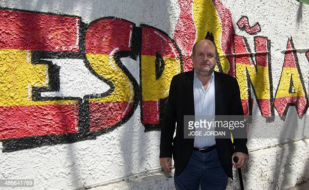 Farright party Espana 2000's president Jose luis Roberto poses in front of a mural reading 'Espana 2000' in Valencia on April 15 2014 Relatively tiny...