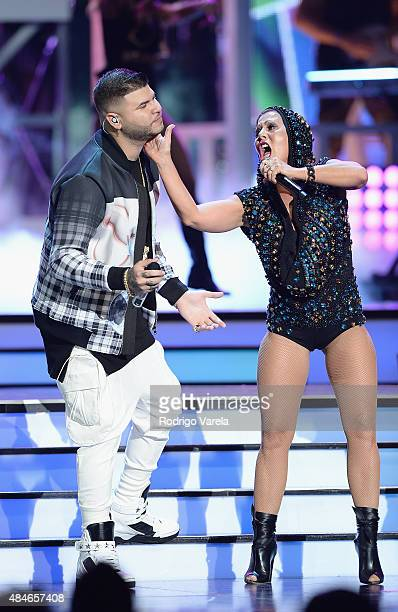 Farruko and Alejandra Guzman perform onstage at Telemundo's 'Premios Tu Mundo' Awards 2015 at American Airlines Arena on August 20 2015 in Miami...