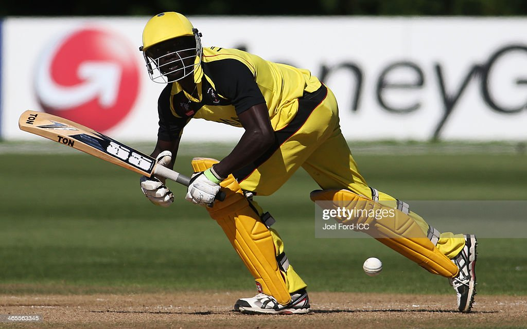 Faruk Ochimi of Uganda plays a shot during an ICC World Cup qualifying playoff between Uganda and Nepal on January 28, 2014 in Mount Maunganui, New Zealand.