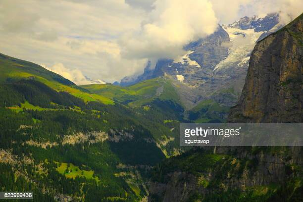Fary tale landscape: Jungfrau, Eiger and Monch massif and glaciers above idyllic Kleine Scheidegg - Grindelwald and Lauterbrunnen alpine valleys and meadows, dramatic swiss snowcapped alps, idyllic countryside, Bernese Oberland,Swiss Alps, Switzerland