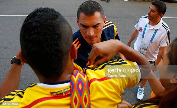 Faryd Mondragón of Colombia signs aoutographs as he heads on for a training session at Universidad de Fortaleza Stadium on July 03 2014 in Fortaleza...