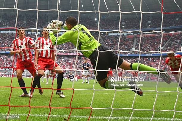Faryd Mondragon keeper of Koeln safes a header from Thomas Mueller of Muenchen whilst Mario Gomez of Muenchen and his team mate Daniel van Buyten...