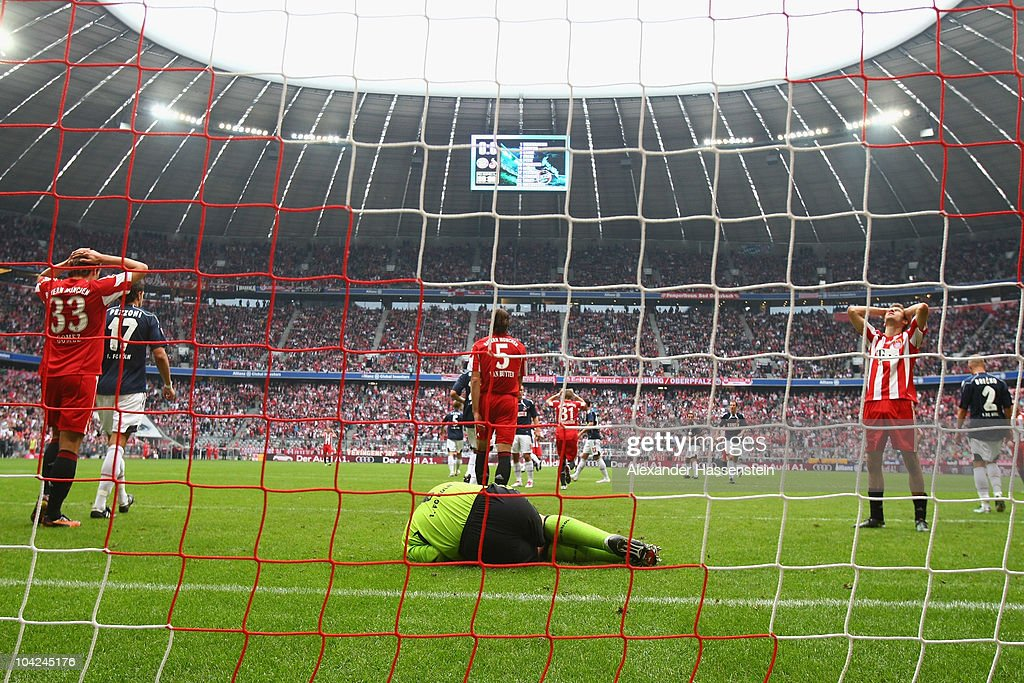 Faryd Mondragon, keeper of Koeln safes a header from Thomas Mueller (R) of Muenchen, whilst Mario Gomez (L) of Muenchen reacts during the Bundesliga match between FC Bayern Muenchen and 1. FC Koeln at Allianz Arena on September 18, 2010 in Munich, Germany.