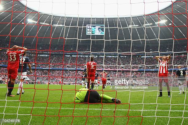 Faryd Mondragon keeper of Koeln safes a header from Thomas Mueller of Muenchen whilst Mario Gomez of Muenchen reacts during the Bundesliga match...