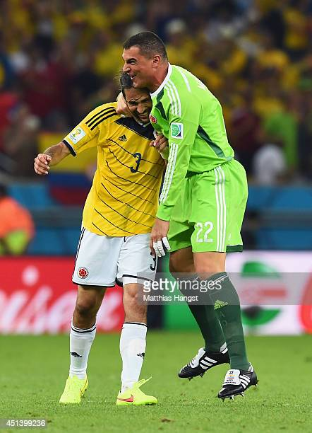 Faryd Mondragon of Colombia celebrates with Mario Yepes defeating Uruguay 20 in the 2014 FIFA World Cup Brazil round of 16 match between Colombia and...