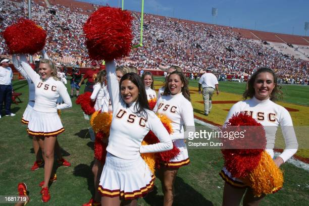Faryn and the USC Trojans cheerleaders dance on the field during the Pac10 Conference football game against the Washington Huskies at the Los Angeles...