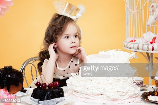 Fascinating little lady posing with tasty treats : Stock Photo