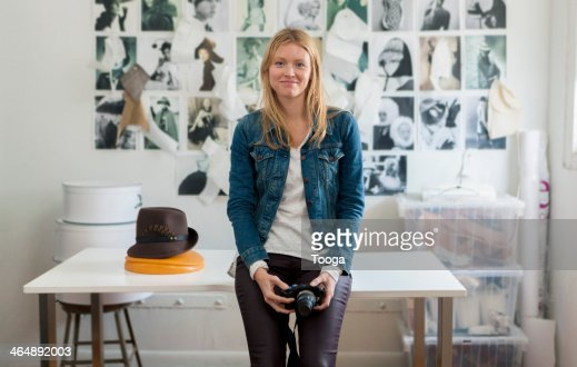 Fashion accessories designer holding camera