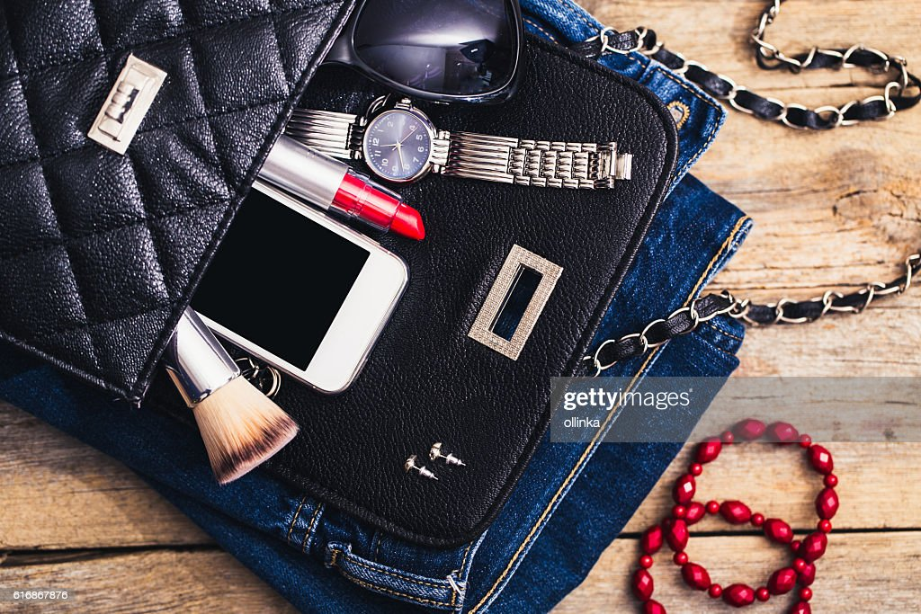 Fashion accessories for a young girl, watch, bracelet, handbag : Stock Photo