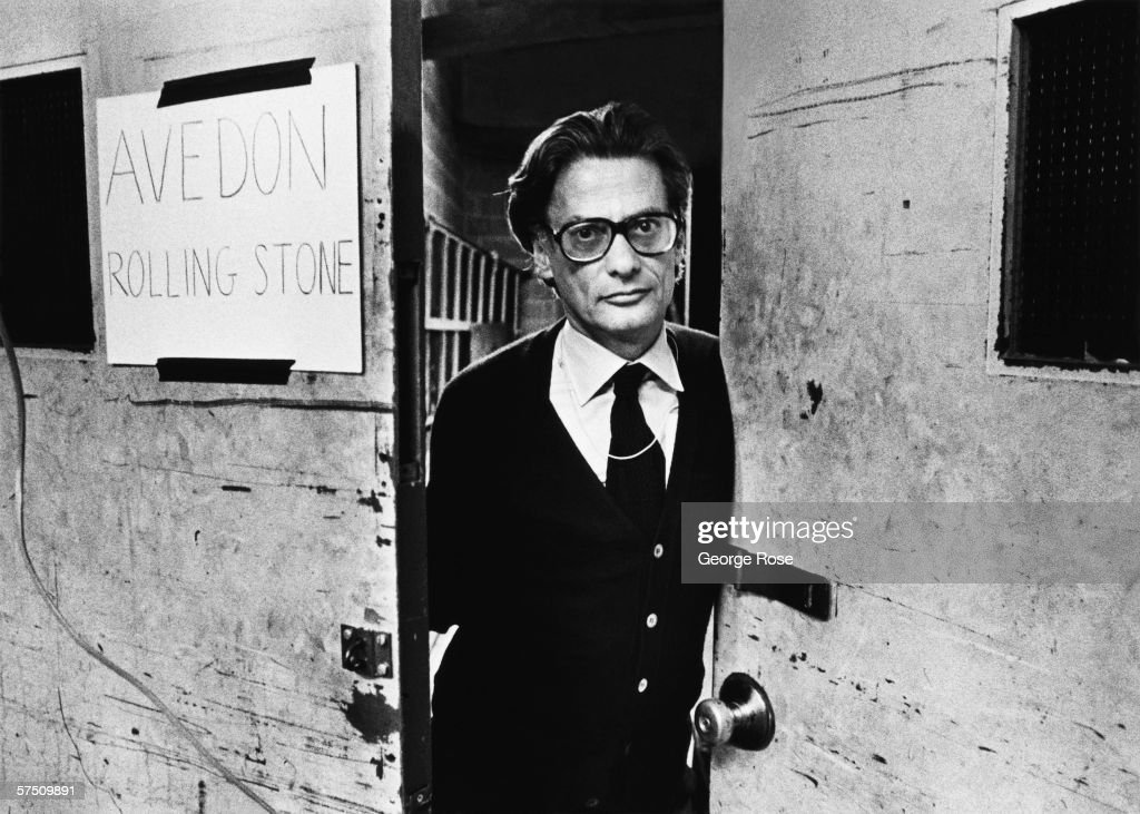Fashion and celebrity photographer Richard Avedon pops his head through the door of his makeshift studio in the basement of Madison Square Gardens...