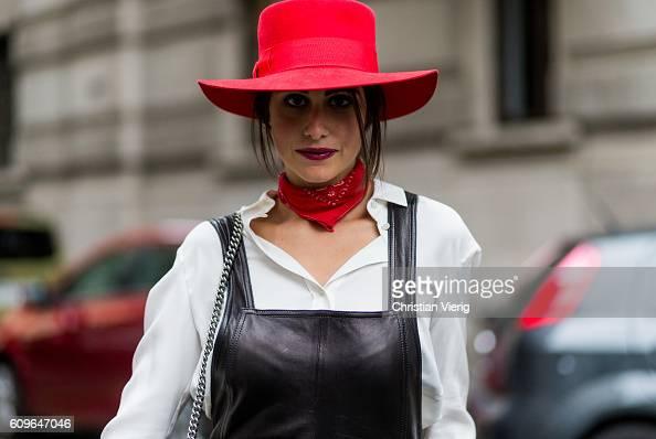 Fashion and lifestyle blogger Nour Arida wearing a black Saint Laurent biker jumpsuit a red Saint Laurent hat a Joseph classic cut white shirt and...