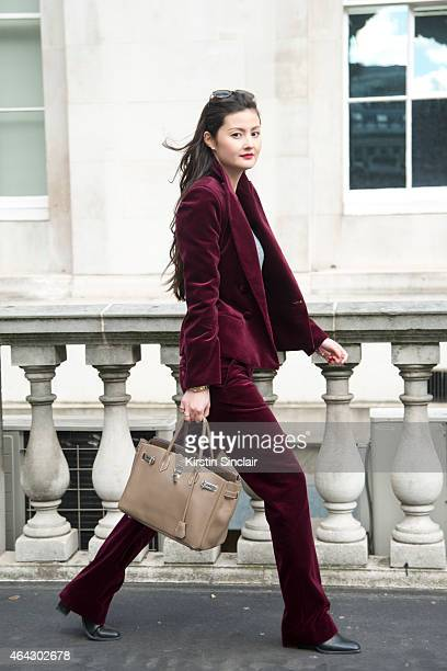Fashion and Lifestyle Blogger Peony Lim wears a tailor made trouser suit a Gap top Zara sunglasses Saint Laurent shoes and an MS bag on February 21...