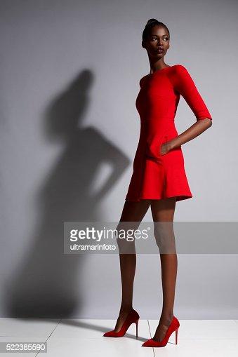 Fashion  Beautiful african ethnicity  young women   Wearing a red dress