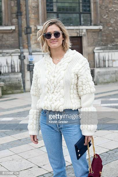 Fashion blogger Adenorah wears a Berenice sweater Levi'u2019s jeans Chanel bag and vintage sunglasses on day 3 during London Fashion Week...